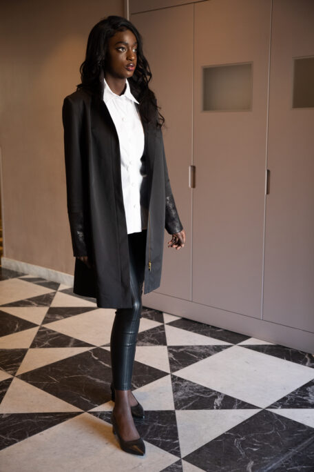 Suede leather details on a black classic coat