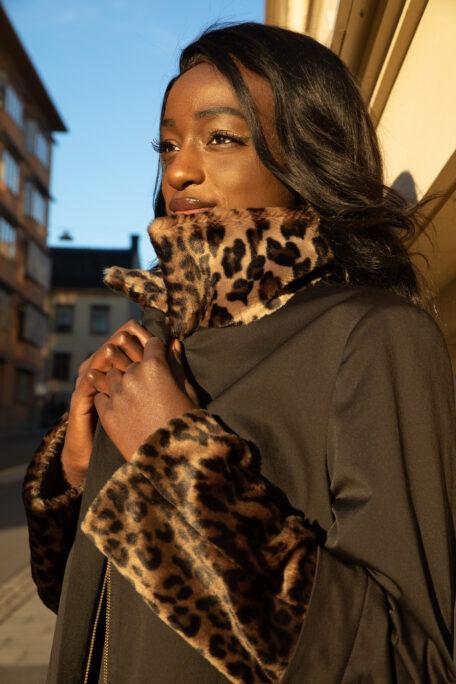 smart womans coat with leopard fur
