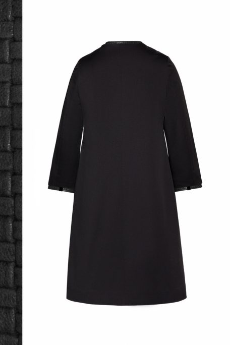 The Christine coat - is a smart coat with a black braided leather set - back view.