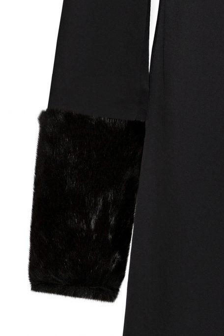 A smart coat with detachable black faux fur sleeves.
