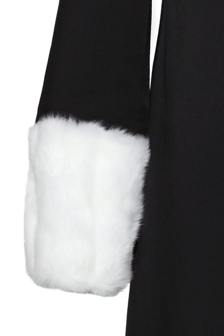 A smart coat with detachable white faux fur sleeves - front view.