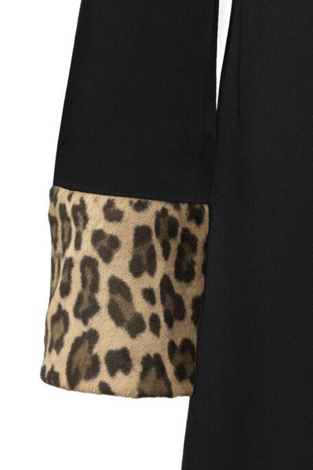 leopard fur sleeves on black womans coat