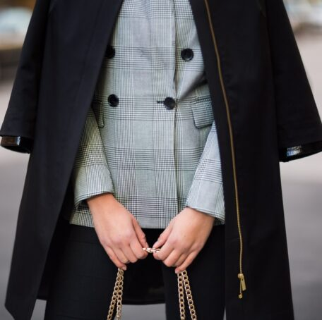 Black female coat with a patent leather details