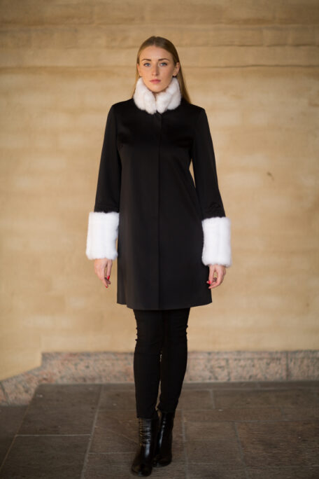 The Madeleine coat with white faux fur on the sleeves and collar