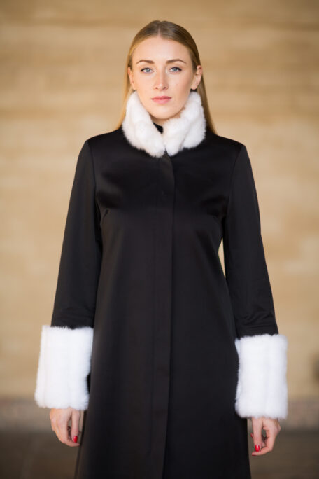 The Madeleine coat with the white faux fur sleeves and collar